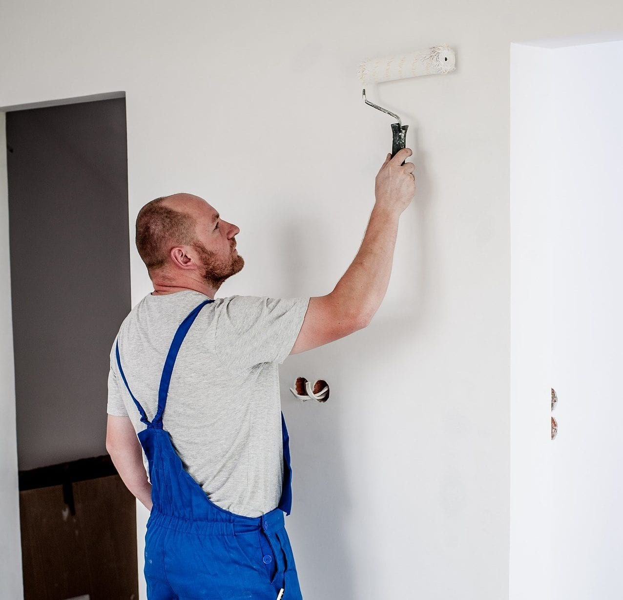 man painting house white interior
