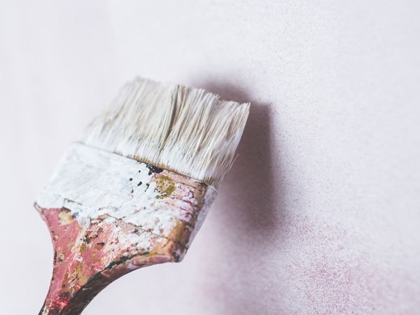 Paint brush and wall