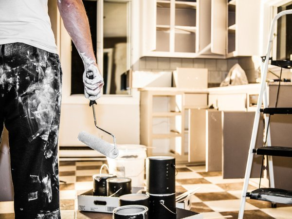 Man painting kitchen cabinets