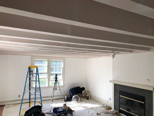 Man painting a house interior