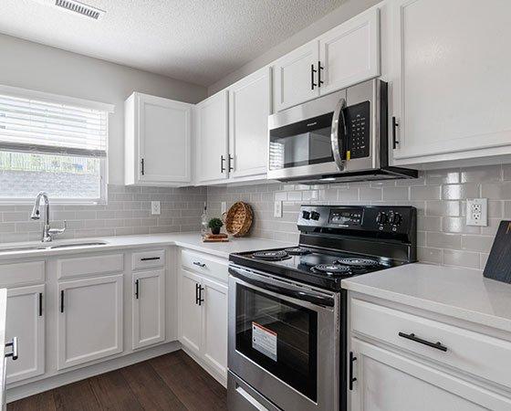 Newer white kitchen cabinets